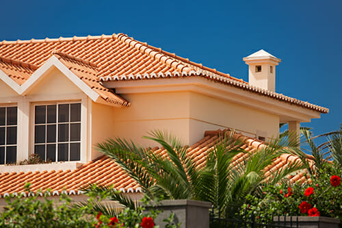 Orange tiled roof of a large house